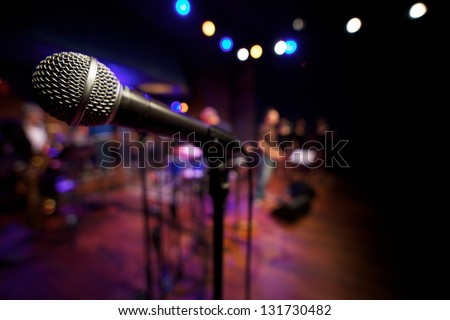 Close up microphone on music stage - stock photo