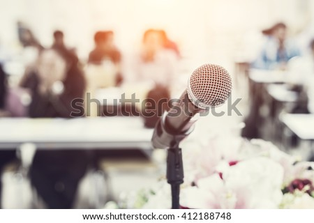 Close up microphone on the desk in meeting room with blur people background, Vintage filter effect