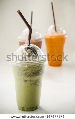 Close up Milk Green tea smoothie in plastic cup - stock photo