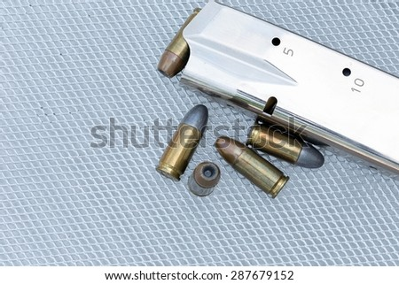 Close up 9 mm pistol ammunition is placed on the grill. - stock photo