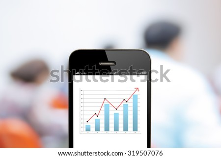 close up  mobile phone with analyzing graph,planing,business success - stock photo