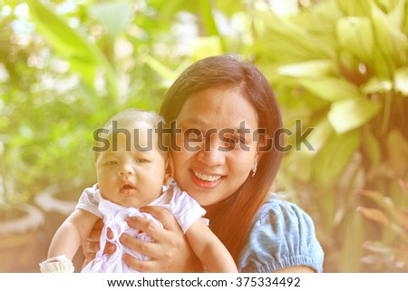 Close up mommy and infant with happiness face