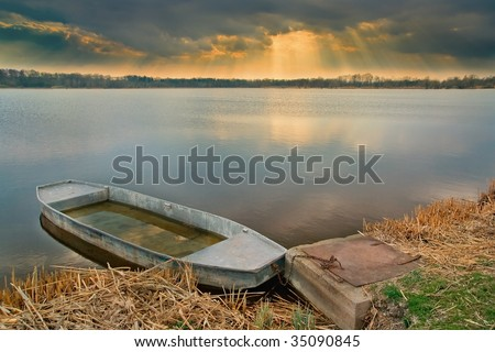 Close up mooring old small boat a in evening light - stock photo