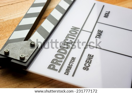 Close up movie slate film on wooden table - stock photo