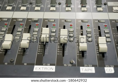 Close up multi color buttons of sound mixer console, shallow depth of field (DOF)