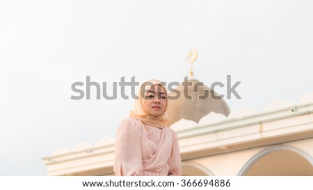 Close up muslim woman stand front of masque - stock photo