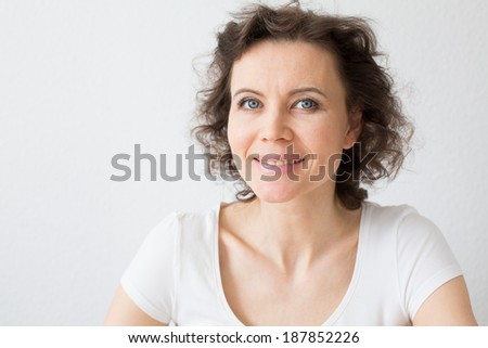 Close-up natural portrait of woman 30-40 years old with attractive smile - stock photo