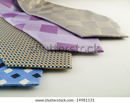 Close Up Neck Ties Showing Silk Pattern on Rich Cloth - stock photo