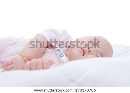 Close-up newborn baby sleeping with digital mercury thermometer