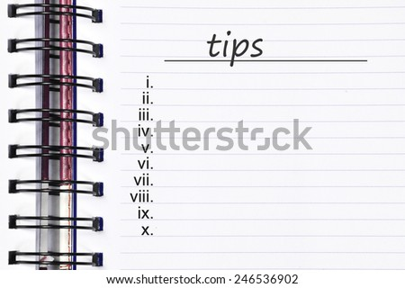 Close up note book and list of tips - stock photo