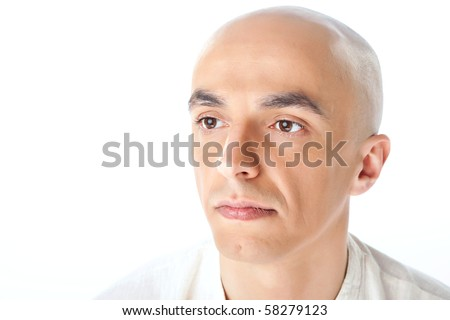 Close-up of a bald man's face isolated on white background