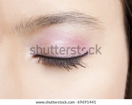Close-up of a beautiful female eye with makeup - stock photo