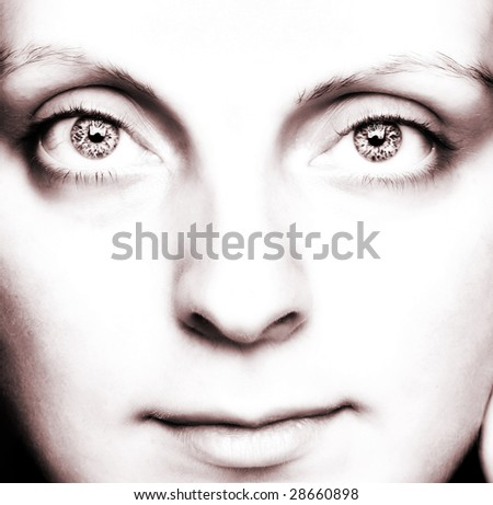 Close-up of a beautiful girl's face with INCREDIBLE blue eyes