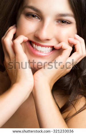 Close up of a beautiful girl smiling - stock photo