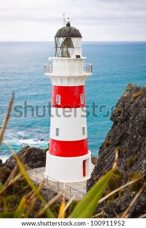 Close-up of a beautiful lighthouse at Cape Palliser, North Island, New Zealand - stock photo