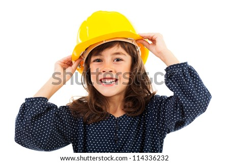 Close up of a beautiful little girl wearing construction helmet, isolated on white