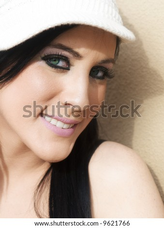 Close up of a beautiful smiling young fashion model