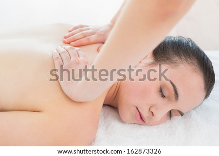 Close up of a beautiful woman enjoying back massage at beauty spa