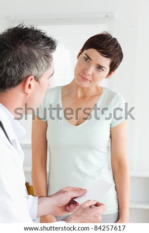 Close up of a Beautiful Woman receiving a prescription in a room