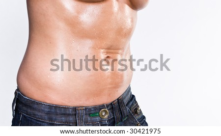 Close up of a beautiful woman's wet  waist isolated on a white background - stock photo