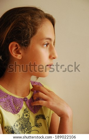 Close up of a beautiful young girl with lace collar - stock photo