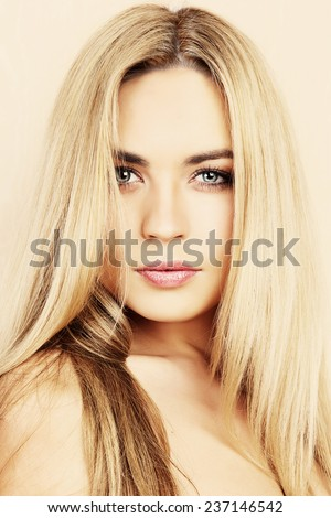 Close-up of a beautiful young woman looking away. - stock photo
