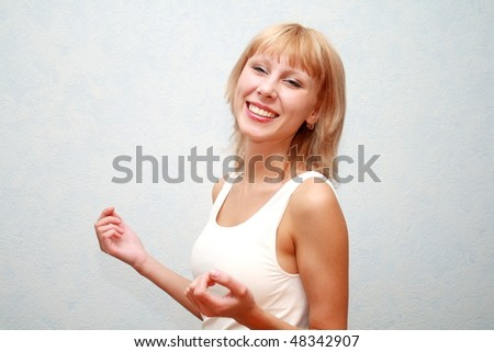 Close-up of a beautiful young woman smiling.Lots of copy space and room for text. - stock photo