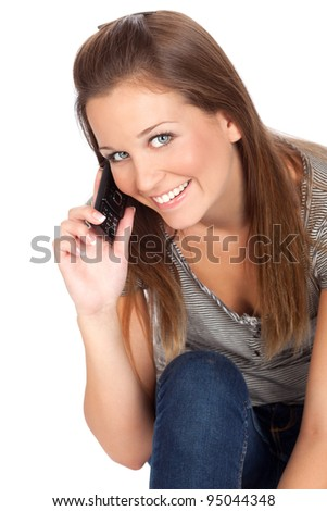 Close up of a beautiful young woman talking on a mobile/cell phone, isolated on white