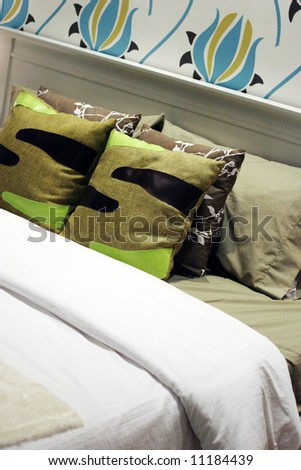 Close-up of a bed in a modern house - home interiors. - stock photo