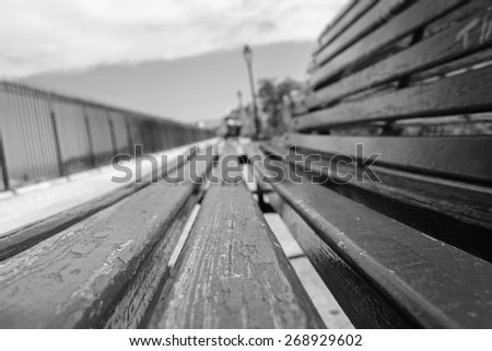 Close-up of a bench, selective focus (black and white picture) - stock photo