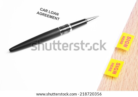 Close Up Of A Black Pen And Car Loan Agreement With Sign Here Stickers  - stock photo