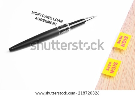 Close Up Of A Black Pen And Mortgage Loan Agreement With Sign Here Stickers  - stock photo