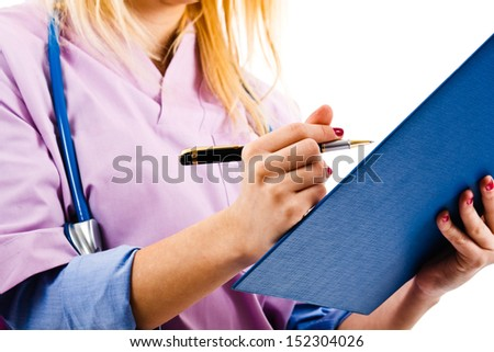 Close-up of a blonde nurse writing - stock photo
