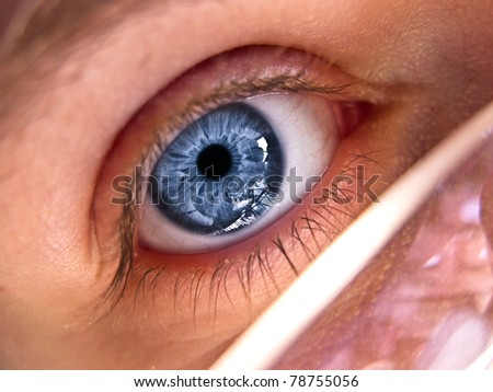 Close up of a blue eye - stock photo