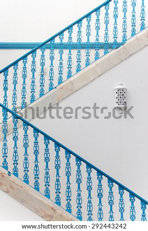 Close up of a blue iron portuguese fence detail on a staircase.  - stock photo