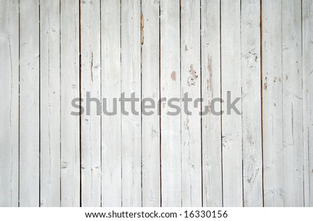 Close up of a blue wooden fence