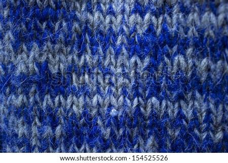 Close-up of a blue woolen pattern. Knitting pattern - stock photo