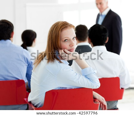 Close-up of a bored businesswoman at a conference - stock photo