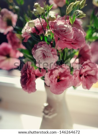 close-up of a bouquet of pink roses in a beautiful decorative vase - stock photo