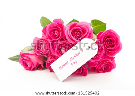 Close up of a bouquet of pink roses with a happy mothers day card on a white background - stock photo