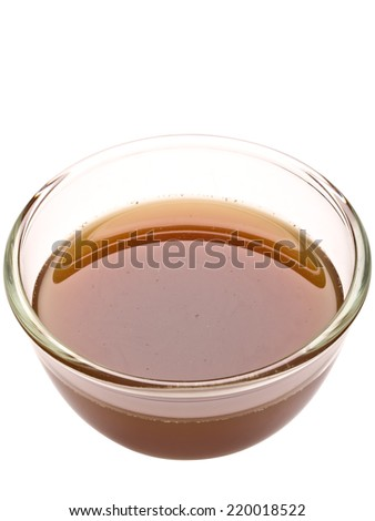 close up of a bowl of beef stock isolated - stock photo