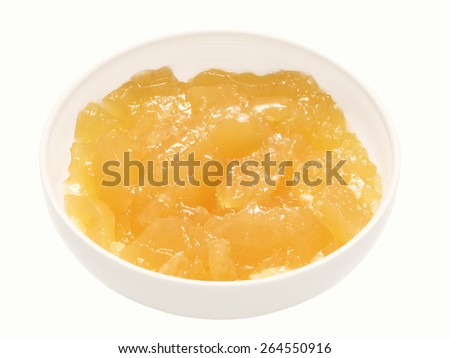 close up of a bowl of chicken stock gel isolated - stock photo