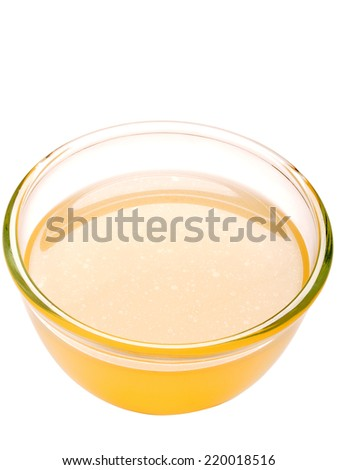 close up of a bowl of chicken stock isolated - stock photo
