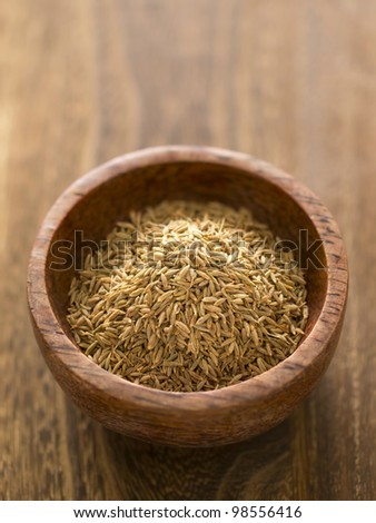 close up of a bowl of cumin seeds