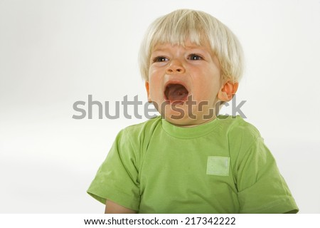 Close-up of a boy crying - stock photo
