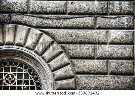 close up of a brick wall with door in hdr tone mapping effect - stock photo