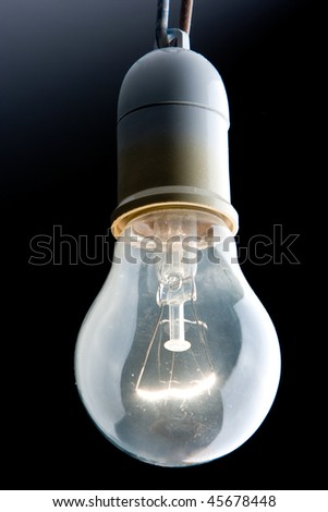 close up of a bright tungsten filament bulb