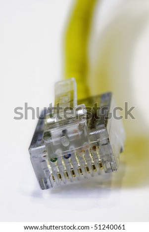 close up of a broadband cable plug with focus on plug - shallow dof - stock photo