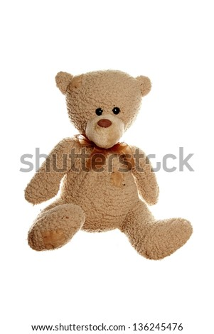 Close up of a brown teddy bear. Isolated on white background