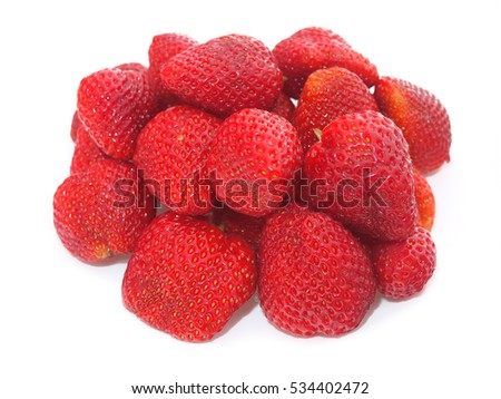 Close up of a bunch of large red berries strawberries isolated on white background
